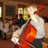 Nolan at cello solo recital